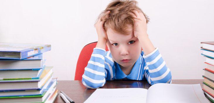 boy frustrated at desk