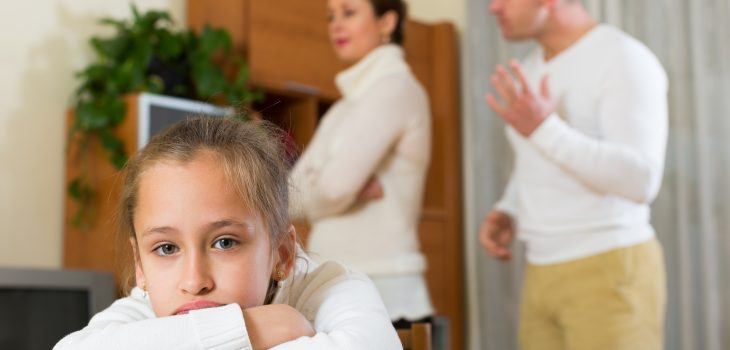 girl in front of fighting parents